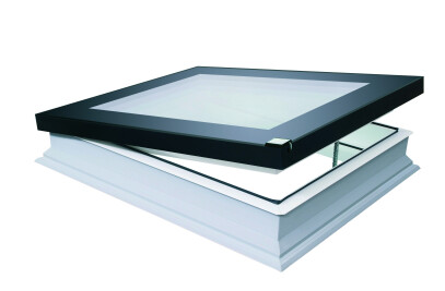Flat roof deck mounted skylight