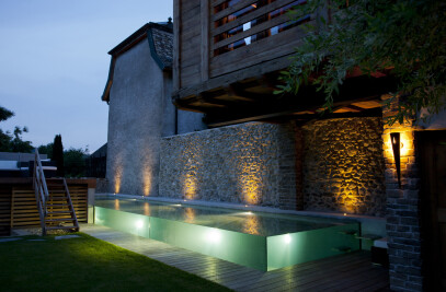 Swimming pool with glass walls