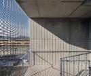 Semi-transparent metal mesh as car park cladding.