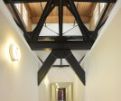 Hallway with Industrial Beams and Breakers