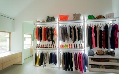 modern walk-in closet in bedroom