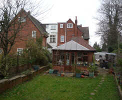 Back garden crowded with multiple rear extensions at a1900s family home
