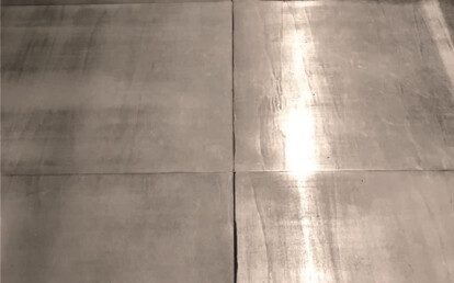Wooden flooring covered with metal