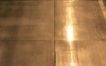 Wooden flooring covered with brass
