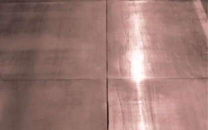 Wooden flooring covered with copper