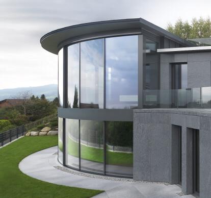 Curved frameless sliding windows