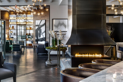 The H Series fireplace by European Home: a 3-sided linear fireplace paired with a custom steel vent hood creates a stunning statement in the St. Gregory hotel lobby.