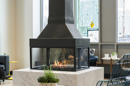 A unique focal point: grab your cappuccino & muffin and slide up to a 360 degree fireplace
