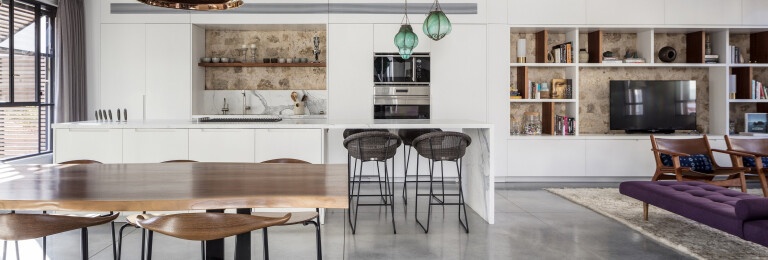 A custom made kitchen that becomes a library and vice versa