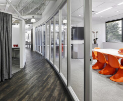 The Optos wall sets off the meeting space from hallway traffic—yet seems to dissolve into the space.
