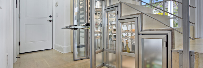 Stamford on the water - innovative stainless steel under stair wine cabinet
