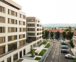 The block is situated in the city center, in a quiet street with an abundance of greenery, but within reach of the city bustle