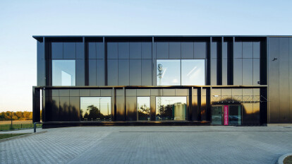 the elevation from the maneuvering square, The material applied to the facade of the object changes its hue depending on the time of day and sunshine