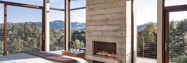 The master suite becomes one with the outdoors, thanks to an array of Western Window Systems doors and windows.