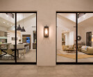 With the two multi-slide doors opened, the kitchen/dining/living space becomes one with the outdoors.