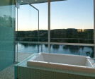 Giant walls of glass and a wrap-around balcony take soaking in the tub to a new level.
