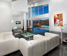 A massive pocketing multi-slide door seamlessly blends the home's great room with the stunning pool area out back.