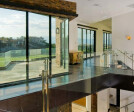 A bank of Western Window Systems multi-slide doors lets in tons of natural Nevada light.