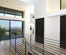 A massive sliding door opens up to a balcony overlooking Los Angeles, letting in copious amounts of natural light and Southern California breezes.
