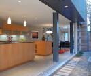 The modern, open kitchen gets even bigger when the massive Series 600 Multi-Slide Door is open.