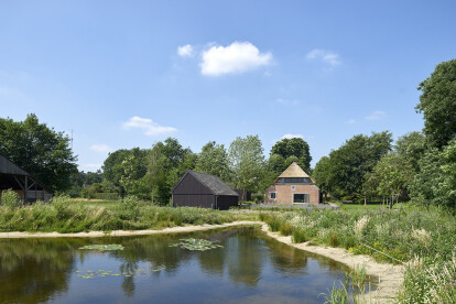 new situation of the farm with yard and swimming pond in nature garden