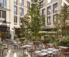 The newly-accessible central courtyard provides public seating and outdoor dining space for two restaurants.