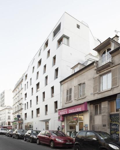 14 housing units + 1 retail space