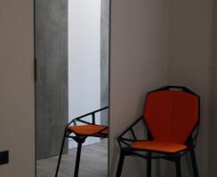 "Bedroom - Additional storage space is ""hidden"" behind the mirror"
