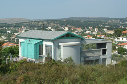 House as seen from upper slope
