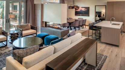 The moment you walk into the door of the one of these Limelight condos you are greeted with a warm palette and clean, modern lines.
