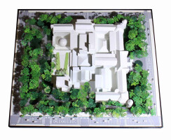 A site model of the proposed renovation illustrates how the building will be inserted into the existing Museum campus (shown here in the lower center)
