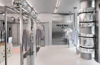 PEU À PEU by JNBY