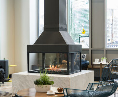A unique focal point: This 4 sided fireplace by Element4 features views of the fire from all 4 sides.  This is a wonderful design feature for large, communal, spaces.