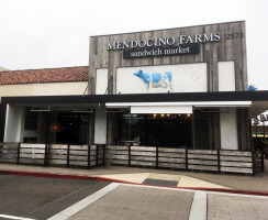 Textural reclaimed wood and a playful blue dairy cow greet you as you enter into Mendocino Farms.