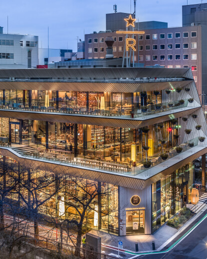 Kengo Kuma completes terraced Starbucks wrapped around a copper cask