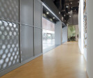 The space is designed with large perforated sliding entrance doors kept open during opening hours to draw vistitors in to witness dancers at work