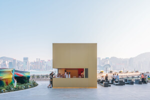 OMA realize gold colored anodised aluminum kiosk at Hong Kong's waterfront