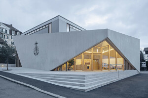 LOCALARCHITECTURE wraps Lausanne church extension in an exposed textured concrete shell