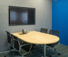 Nutanix corporate office design by Space Matrix - Meeting room in blue