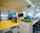 Azqore is a startup office design done stylishly in bold, bright yellow colours by Space Matrix