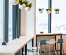 Corporate interior design of Forrester Singapore - Pantry in light colours with a view, designed by Space Matrix