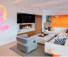 Bidore 140 by Element4: This wall has it all – beautiful wood cabinets, a discrete television installation, a corner fireplace and even a Bowie/Prince hybrid neon art piece! What more could you ask for?