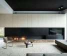 Embrace asymmetry: sure the architect could have called for a 15′ linear fireplace to run the length of this wall, but the real question is, would that make this space any more interesting?