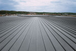 Click roll cap roofing system