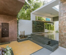 One enters the residence through the cantilevered entrance portico and is led into a large verandah.