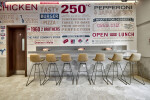 Domino's pizza counter and tables