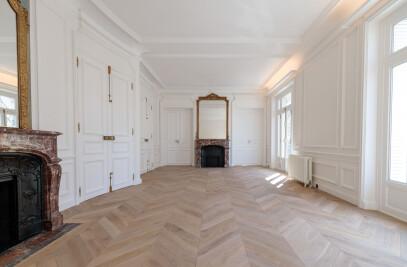 Aged chevron parquet flooring