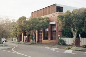 Breathe Architecture transforms 40's era Australian brick warehouse into 11 ethical apartment units