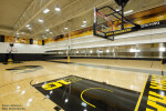 Skyfold movable wall retracting automatically into ceiling pocket in a school gym