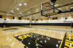 Skyfold movable wall in ceiling pocket to open school gym into one large space